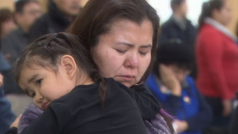 The parents of missing mill worker Carl Charlie light candles of hope in Burns Lake, B.C. Jan. 22, 2012. (CTV)