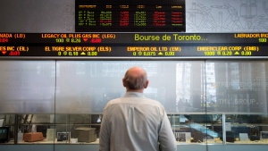 A man watches the financial numbers at the TMX Group in Toronto's financial district, May 9, 2014. (Darren Calabrese/The Canadian Press)