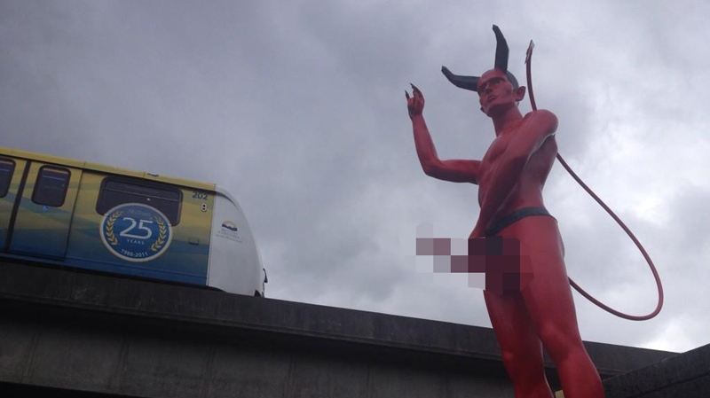 A racy statue of the devil sprang up near the Clark Drive SkyTrain station overnight, and nobody seems to know how or why it got there. Sept. 9, 2014. (CTV)