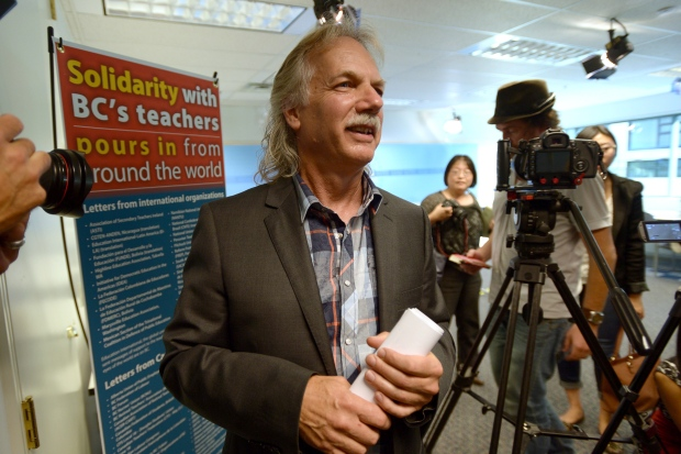 B.C. Teachers' Federation President Jim Iker leaves a news conference in Vancouver, Tuesday, Sept. 16, 2014. (Jonathan Hayward / THE CANADIAN PRESS)