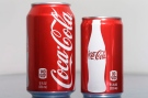 A 7.5-ounce can of Coca-cola, right, is posed next to a 12-ounce can for comparison, Monday, Jan. 12, 2015 in Philadelphia. (AP / Matt Rourke)