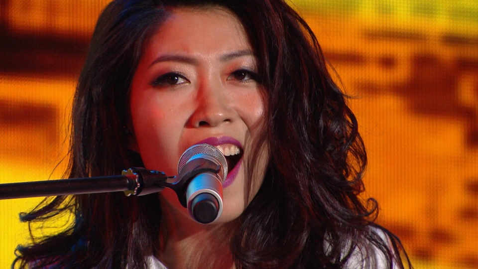 Chinese-Canadian star Wanting Qu performs on stage during a 25-city tour in China.