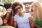 A new study suggests extroverted people are more likely to feel intimidated by the appearance of their friends' active social lives. (Monkey Business Images / Shutterstock.com)