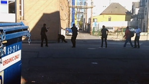 Police surround a stabbing suspect in Vancouver's Downtown Eastside in an image taken from video obtained by CTV News. April 9, 2015.