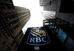 A Royal Bank of Canada sign is pictured in downtown Toronto. The Royal Bank is backing off on its plan to charge customers a fee to make credit card, loan and mortgage payments under certain circumstances. (Nathan Denette / THE CANADIAN PRESS)
