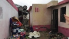 A vehicle lies on the rooftop of a home after a powerful tornado swept through Ciudad Acuna, northern Mexico, Monday, May 25, 2015. <br> <br> A tornado raged through Ciudad Acuna on the U.S.-Mexico border Monday, destroying homes and flinging cars like matchsticks. At least 13 people were killed, authorities say.  (AP)