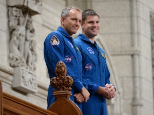 Canadian astronauts Jeremy Hansen (right) and David Saint-Jacques stand in the visitors gallery after being recognized in the House of Commons in Ottawa on Tuesday, June 2, 2015. THE CANADIAN PRESS/Sean Kilpatrick