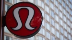 Lululemon Athletica's logo is seen on the outside of their new flagship store on Robson Street during it's grand opening in downtown Vancouver, B.C., on Thursday August 21, 2014.  (THE CANADIAN PRESS/Darryl Dyck)