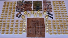 Gold ingots and Buddha figurines