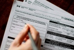 A T1 General 2010 tax form is pictured this April 2011 file photo. (Chris Young / THE CANADIAN PRESS)