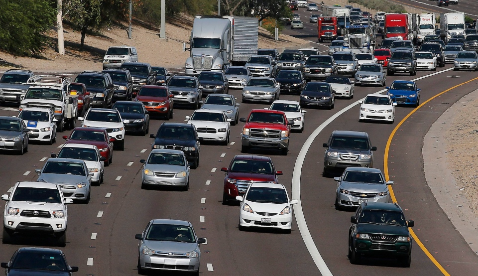 In this June 24, 2015, file photo, afternoon rush our traffic moves along a highway in Phoenix. (AP / Ross D. Franklin, File)