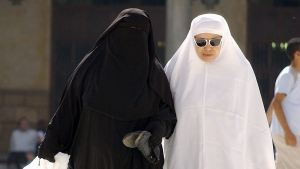 Muslim women, wearing a niqab, left, and at right a khemar, leave Al-Azhar Mosque after Friday prayers in Cairo, Egypt Friday, Oct. 27, 2006. (AP Photo/Mohammed Sehety)