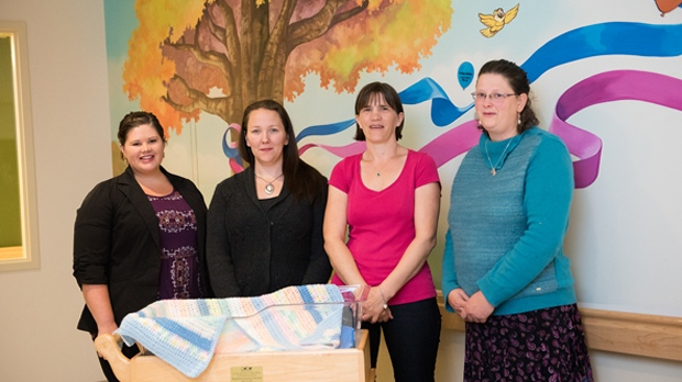 Annet Janssen (third from the left) and some of the CuddleCot group: Dana Selles, Chelsea Meier, and Wendy Winkelaar. (Marissa Veenbaas ).