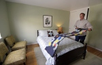 In this Friday, Oct. 16, 2015, photo, Bruce Bennett folds a blanket in a room that he makes available to rent in his home in San Francisco. (AP/Ben Margot)
