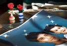 Artwork created by Adnan Syed sits near family photos in the home of his mother, Shamim Syed, in Baltimore on Dec. 10, 2014. (AP / Patrick Semansky)