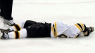 Boston Bruins' Marc Savard lies on the ice after being hit by by Pittsburgh forward Matt Cooke in an NHL hockey game against the Pittsburgh Penguins on March 7, 2010. (AP / Keith Srakocic)