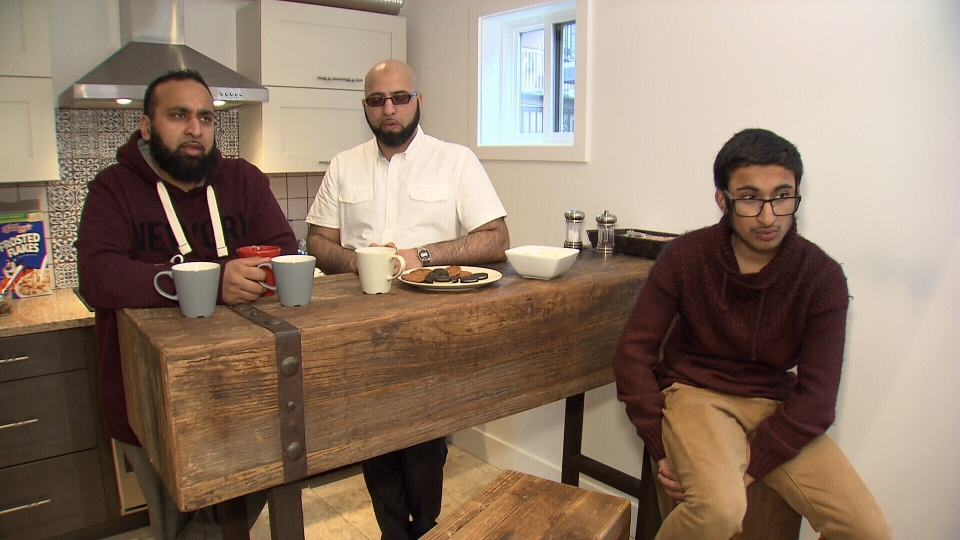 Mohammed Sharaz (left), lives in England and came to Vancouver for treatment for his fourteen-year-old son's genetic eye condition. His friend (middle) came along for vision treatments as well. Jan. 16, 2016. (CTV News).