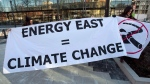 Members of Stop Energy East Halifax protest outside the library in Halifax on Monday, Jan. 26, 2015. (Andrew Vaughan / THE CANADIAN PRESS)