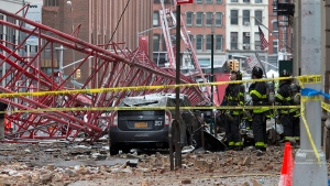 Firefighters work at the scene of a crane collapse in lower Manhattan, Friday, Feb. 5, 2016 in New York. (AP / Mary Altaffer)