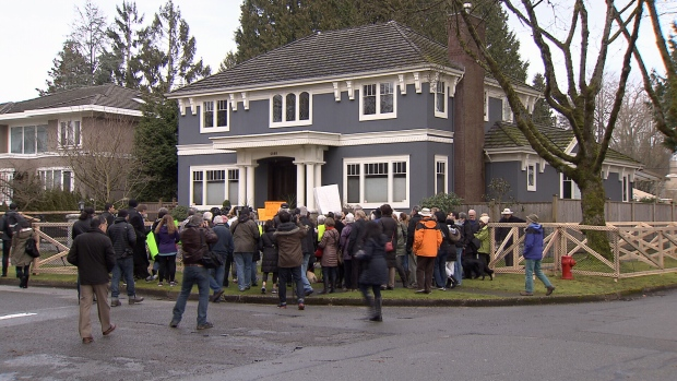 Dozens protested outside the Shaughnessy mansion on Sunday to send a message to the city. Feb. 7, 2016. (CTV News).
