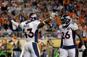 Denver Broncos' T.J. Ward (43) celebrates with Darian Stewart (26) after Ward recovers a fumble during the second half of the NFL Super Bowl 50 football game on Feb. 7, 2016, in Santa Clara, Calif. (Matt York / AP Photo)