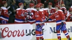 Washington Capitals left wing Alex Ovechkin celebrates his goal with teammate Dmitry Orlov  and others during the second period of an NHL hockey game against the Philadelphia Flyers in Washington on Sunday, Feb. 7, 2016. (AP / Nick Wass)