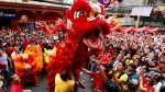 Dragon and lion dancers perform before a huge crowd in celebration of the Chinese Lunar New Year Monday, Feb. 8, 2016 at Manila's Chinatown district in Manila, Philippines. This year is Year of the Monkey in the Lunar calendar. (AP / Bullit Marquez)