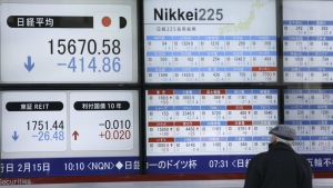 A man looks at an electronic stock board showing Japan's Nikkei 225 in Tokyo, Wednesday, Feb. 10, 2016. (AP / Eugene Hoshiko)