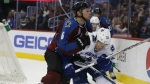 Colorado Avalanche defenseman Erik Johnson, left, defends against Vancouver Canucks centre Bo Horvat as he pursues the puck in the third period of an NHL hockey game in Denver on Tuesday, Feb. 9, 2016. (AP / David Zalubowski)
