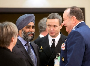 Defence Minister Harjit Singh Sajjan, second left, speaks with Supreme Allied Commander Europe, Gen. Philip Breedlove, right, during a meeting of the North Atlantic Council at NATO headquarters in Brussels on Wednesday, Feb. 10, 2016. (AP / Virginia Mayo)