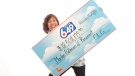 Marilyn Pidlaoan holds her cheque for $18.3 million. (Ontario Lottery and Gaming Corporation)