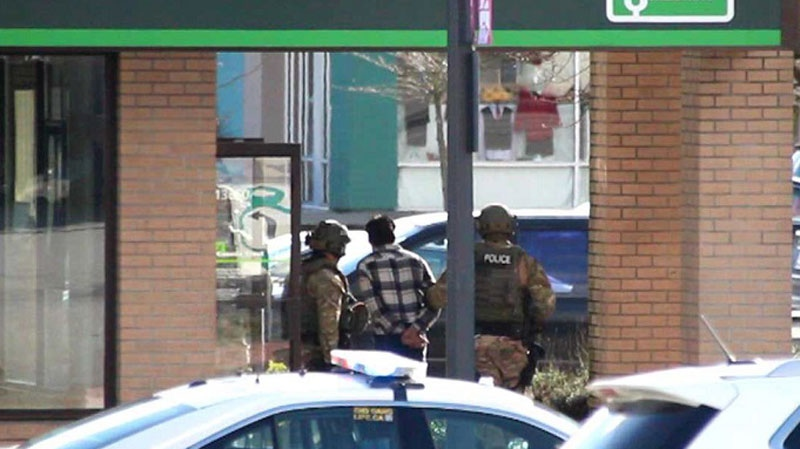 A suspected bank robber is arrested following a six-hour standoff in Surrey's Newton neighbourhood. Feb. 16, 2016. (CTV)