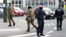 In this file photo, police and Belgian Army soldiers patrol outside the federal court building in Brussels on Thursday, April 14, 2016. (AP Photo/Virginia Mayo)