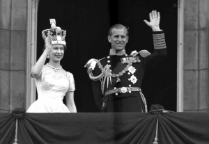 Queen Elizabeth II and Prince Philip, Duke of Edinburgh, as they wave to supporters from the balcony at Buckingham Palace, following her coronation at Westminster Abbey, London, June. 2, 1953. (AP Photo/Leslie Priest)