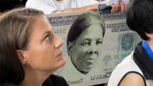 A woman holds a sign supporting Harriet Tubman for the $20 bill in Seneca Falls, N.Y., on Aug. 31, 2015. (Carolyn Thompson / AP)