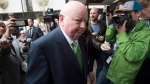Sen. Mike Duffy makes his way towards his car as he leaves the courthouse, Thursday, April 21, 2016 in Ottawa. Duffy has been cleared of all 31 fraud, breach of trust and bribery charges he had been facing in relation to the long-running Senate expense scandal. THE CANADIAN PRESS/Adrian Wyld