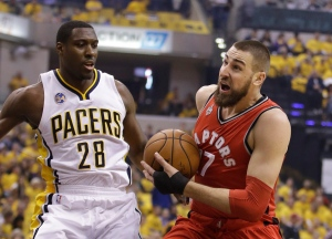 Toronto Raptors' Jonas Valanciunas (17) goes to the basket against Indiana Pacers' Ian Mahinmi (28) during the first half of Game 6 of an NBA first-round playoff basketball series on April 29, 2016, in Indianapolis. (Darron Cummings / AP Photo)