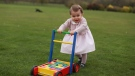 In this undated handout photo released on Sunday, May 1, 2016 by Kensington Palace, Britain's Princess Charlotte poses for a photograph, at Anmer Hall, in Norfolk, England. The princess will celebrate her first birthday on Monday. (Kate, the Duchess of Cambridge/Kensington Palace via AP)