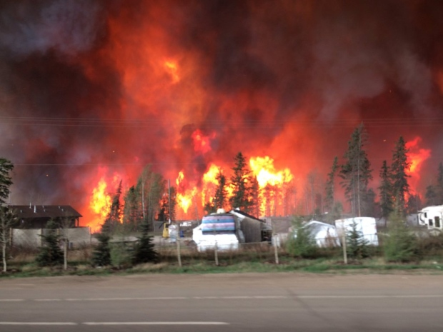 A trailer park on fire near Fort McMurray (Photo: Twitter/@BreannaCTV)