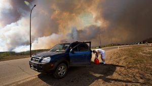 An evacuee puts gas in his car on his way out of Fort McMurray, Alta., on Wednesday, May 4, 2016.  (THE CANADIAN PRESS/Jason Franson)