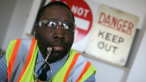 Darius McCollum dressed as a New York City transit worker.