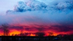 A wildfire moves towards the town of Anzac from Fort McMurray, Alberta., on Wednesday May 4, 2016 (Jason Franson  /The Canadian Press via AP)