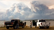 Evacuees watch the wildfire near Fort McMurray, Alberta, on Wednesday, May 4, 2016. (Jason Franson / The Canadian Press)