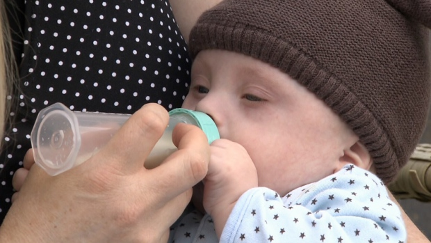 Baby Liam drinks from a bottle at his home in Victoria.