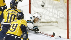 San Jose Sharks centre Joe Pavelski knocks the puck across the goal line as Nashville Predators' Colton Sissons and Roman Josi defend during the first overtime period in Game 4 of an NHL hockey Stanley Cup Western Conference semifinal playoff series in Nashville, Tenn. on Thursday, May 5, 2016. (AP / Mark Humphrey)