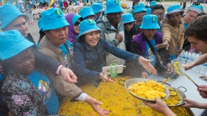 Chinese conglomerate Tiens Group employers are severed Paella in Madrid, Spain, Friday, May 6, 2016. (AP Photo / Paul White)
