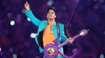 In this Feb. 4, 2007 file photo, Prince performs during the halftime show at the Super Bowl XLI football game at Dolphin Stadium in Miami. (AP Photo / Chris O'Meara, File)
