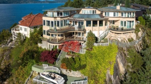 This West Vancouver waterfront mansion comes with stunning ocean views – and a private boat launch and submersible power dock. The luxury property features more than 6,700-square-feet of living space, four-bedrooms, six-bathrooms, a home gym, an indoor lap pool, and a sauna and steam room. Looking for a new home? 5310 Seaside place could be yours for $11.88-million. (Royal LePage Sussex/Jason Soprovich).