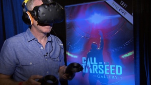 Ross McLaughlin tries out a virtual reality game at the VR convention in Vancouver. (CTV)