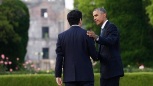 U.S. President Barack Obama, right, and Japanese Prime Minister Shinzo Abe speak with the Atomic Bomb Dome seen at rear at the Hiroshima Peace Memorial Park in Hiroshima, western Japan, Friday, May 27, 2016 (AP / Carolyn Kaster)